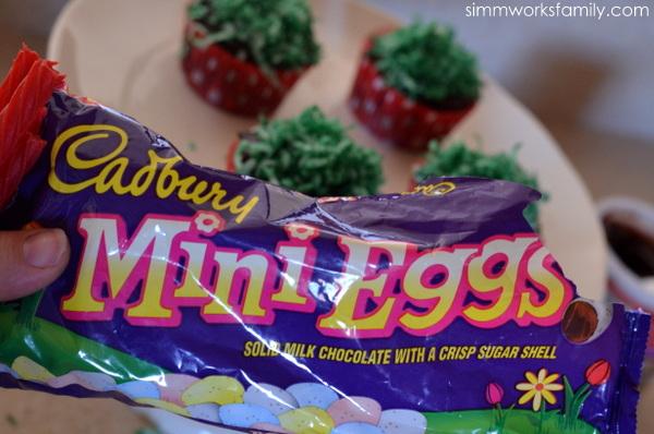Easter Egg Cupcake Baskets adding eggs