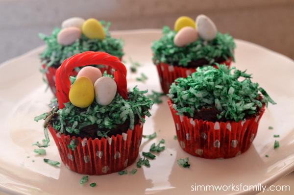 Easter Egg Cupcake Baskets adding licorice handle