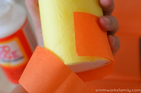 DIY Candy Corn Candles apply tissue paper