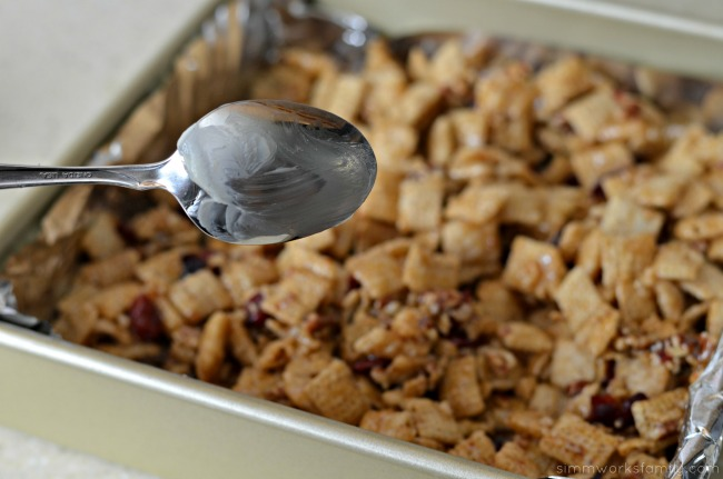 Vanilla Chex Cranberry Pecan Bars butter spoon