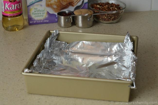 Vanilla Chex Cranberry Pecan Bars line pan