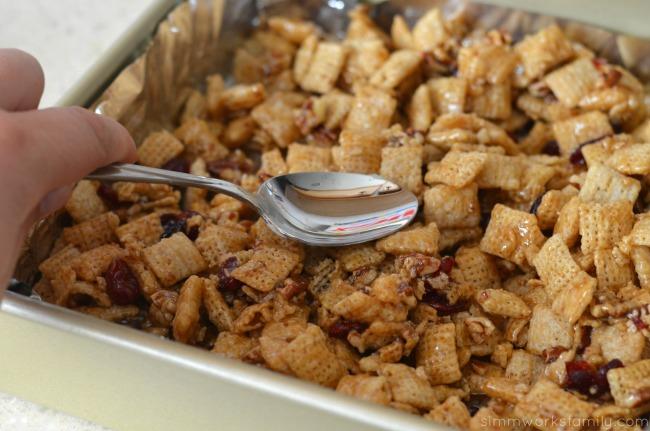 Vanilla Chex Cranberry Pecan Bars spread into pan