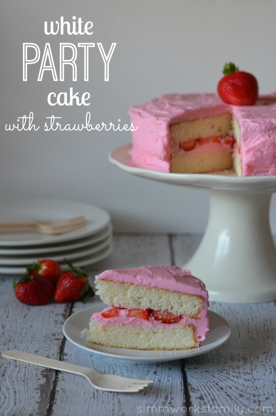 white party cake with strawberries