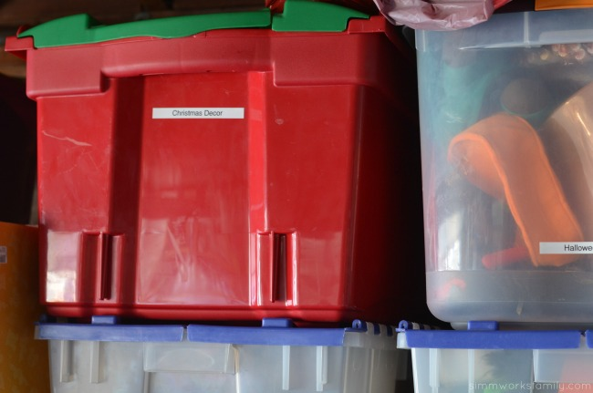 organizing holiday decorations color coded bins