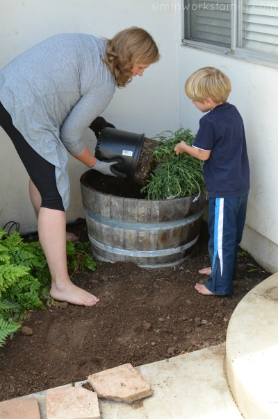 Gardening with Kids pulling out the lavender plant