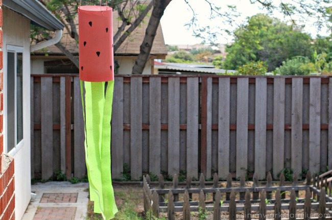 DIY Fruit Juice Dyed Watermelon Windsock in garden
