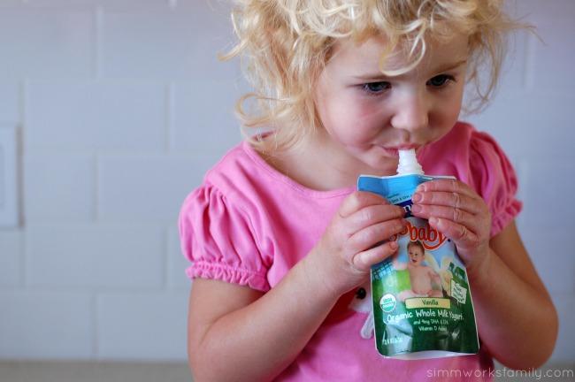 On-The-Go Breakfast Ideas for Busy Mornings enjoying Vanilla YoBaby yogurt pouches