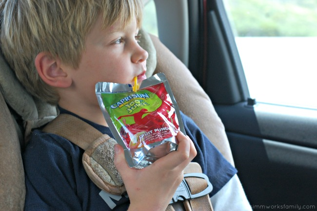 Road Trip with Kids Survival Tips enjoying Capri Sun #CapriSunMomFactor