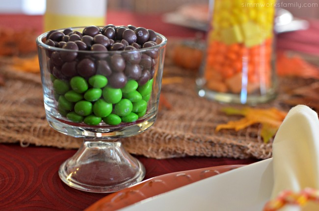Candy Corn Inspired Tablescape frankenstein inspired decor with skittles