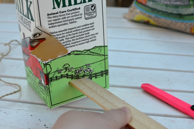 DIY Milk Carton Bird Feeder - add stir stick