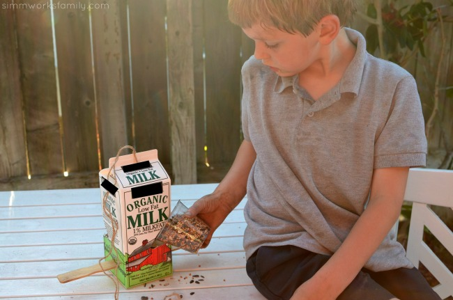DIY Milk Carton Bird Feeder - adding bird seed