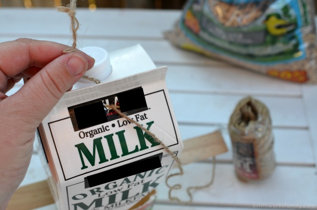 DIY Milk Carton Bird Feeder - thread twine on top
