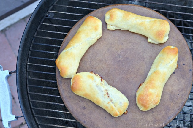 Chili Cheese Crescent Dogs on a pizza stone