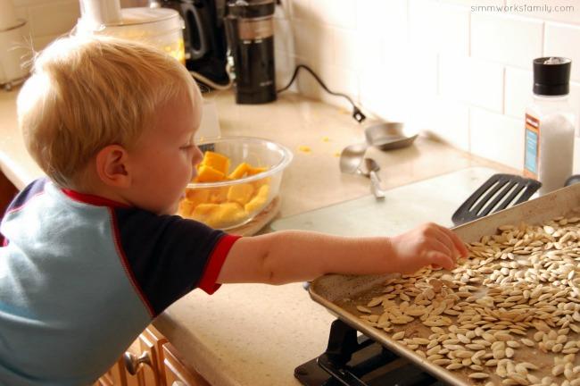 How to Roast Pumpkin Seeds - Ethan eating a few