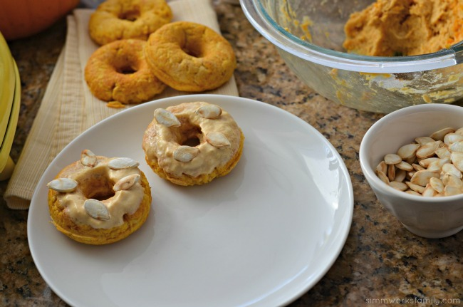 Keto Friendly Pumpkin Donuts - add frosting and roasted pumpkin seeds