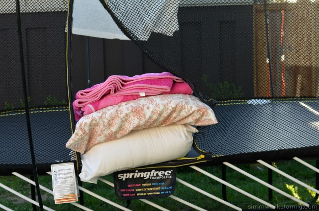 5 Reasons To Be Thankful For Summer + an outdoor movie night idea on a trampoline with blankets and pillows