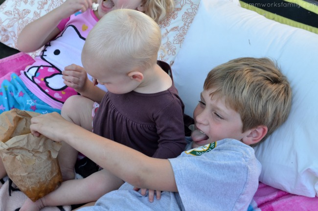 5 Reasons To Be Thankful For Summer + an outdoor movie night idea on a trampoline with siblings