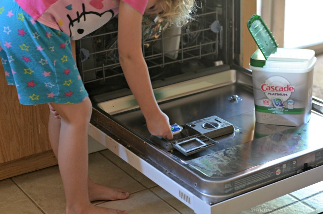 Trading Clean Time for Screen Time This Summer doing the dishes