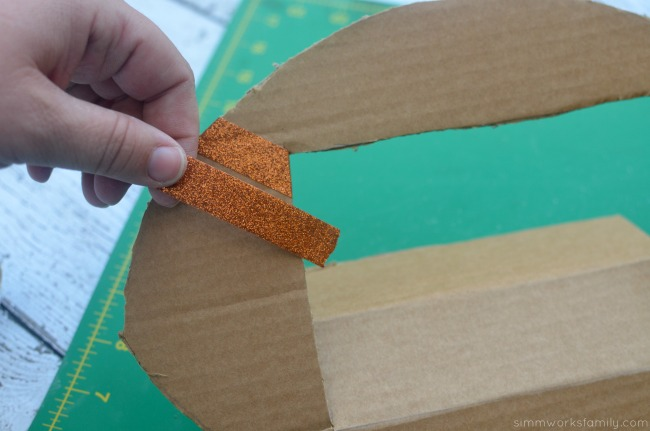 diy-football-photo-frame-add-glitter-tape