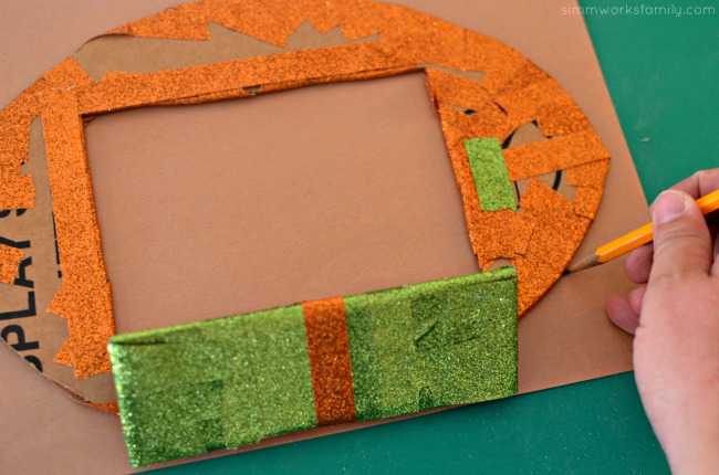 diy-football-photo-frame-trace-out-construction-paper-for-covering-back-of-frame